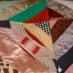 Antique patchwork quilt with satin