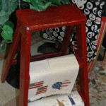 Cute tea towels on red step ladder