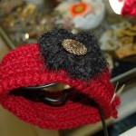 Hand knit headband with sassy button and flower