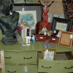 Green dresser and a bust of some historic figure