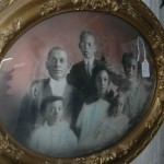 Old family portrait in bubble glass frame