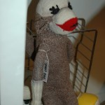 Handmade vintage sock monkey with winsome lashes