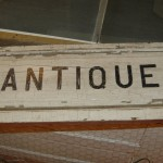 Weathered antiques sign