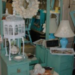 Seafoam green dresser with batwing mirrors