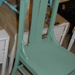 Blue-green chair with casters