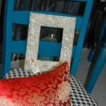 Bright blue chair with houndstooth seat