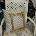 Gray meets gold lovely chair chevron pillow and gilded frame