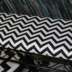 Metal bench with black and white chevron seat