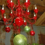Red lacquered chandelier and baubles
