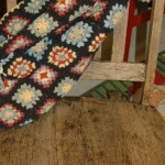 Rustic chair and granny square afghan