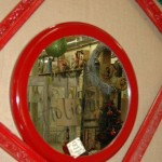 Shiny red lacquered mirror and frame