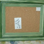 Large green framed corkboard