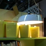 Upcycled enamelware light and cheery yellow cannisters